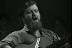 christy moore plays guitar